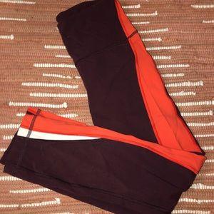 maroon, white, and orange Lululemon leggings
